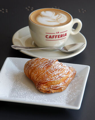 Cappuccino served with sfogliatella at Cafferia 360