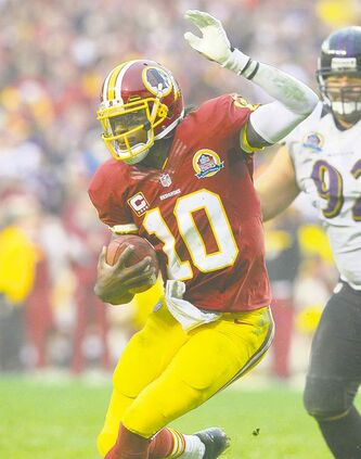A bum knee will keep Redskins quarterback Robert Griffin III out of action today.