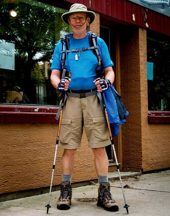 Ivor Lockhart, outside the Neighbourhood Book Store and Cafe, prepares for his walk across Spain to Santiago de Compostela.