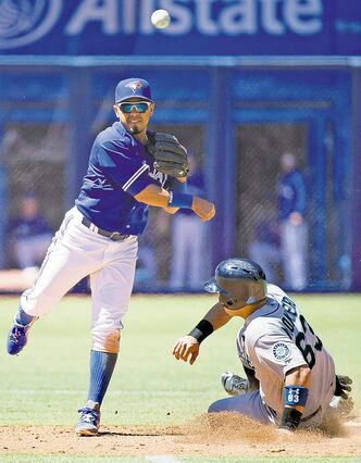 Toronto Blue Jays second baseman Maicer Izturis forces out Seattle Mariners catcher Jesus Montero at second base but can't turn the double-play at first during the  fifth inning Sunday in Toronto.