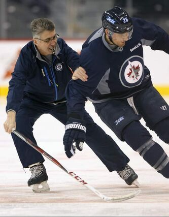 Head coach Claude Noel directs Blake Wheeler through a drill Monday morning during practice at the MTS Centre.
