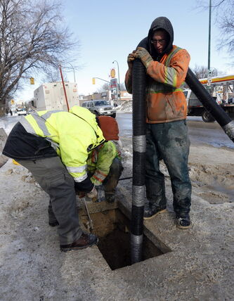Workers prepare to thaw frozen water pipes on Mountain Avenue at Salter Street earlier this month.