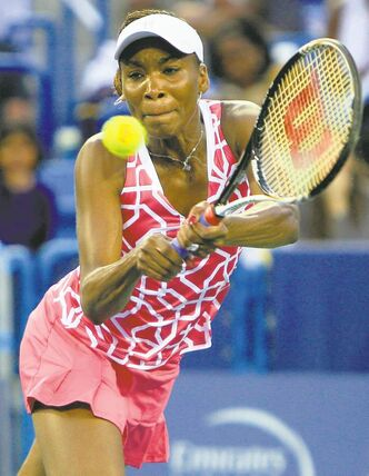 Venus Williams hits a backhand shot against Li Na, from China, during a semifinals match at the Western & Southern Open tennis tournament, Saturday, Aug. 18, 2012, in Mason, Ohio. (AP Photo/Al Behrman)