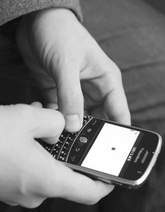 Tyler Barnett begins to write a text message on his cellphone cell phone in Los Angeles on Wednesday, Feb. 11, 2009. (AP Photo/Matt Sayles) close cut closecut