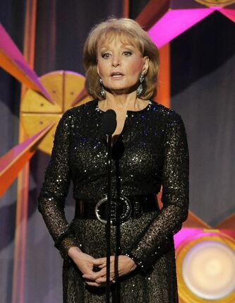 FILE - This June 23, 2012 file photo shows Barbara Walters presenting an award onstage at the 39th Annual Daytime Emmy Awards in Beverly Hills, Calif. Walters, who has been battling the Chicken Pox, will not return to her daytime talk show