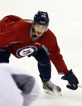 "Defenceman Zach Redmond says, with only two exhibition games left before the season opens, the Jets are ""more of a team, rather than a training camp. Everything starts to get whittled down and fine-tuned."""