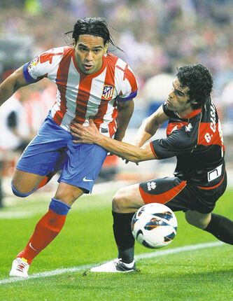 Atletico Madrid's Colombian striker Radamel Falcao (left) is No. 1 on Chelsea's shopping list