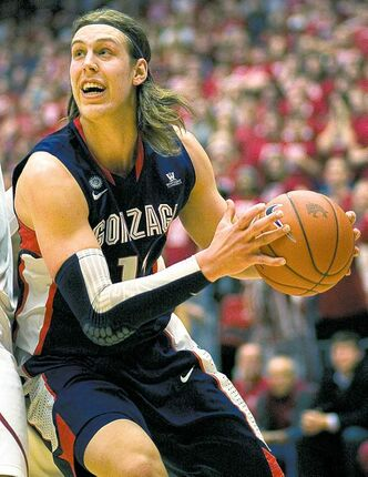 Gonzaga forward Kelly Olynyk (13) drives into Washington State forward Brock Motum, left, during the second half of an NCAA college basketball game Wednesday, Dec. 5, 2012, at Beasley Coliseum in Pullman, Wash. Olynyk scored 22 points. Gonzaga won 71-69. (AP Photo/Dean Hare)  close cut closecut