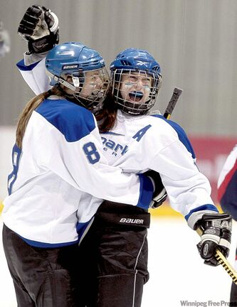 Raiders' Megan Stefanson, right, celebrates her goal with Jackie Ormel Tuesday.