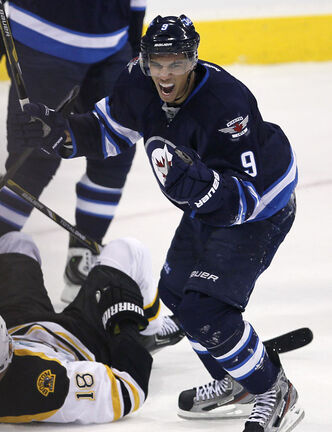 Evander Kane celebrates his goal the against  Boston Bruins during second period NHL action.