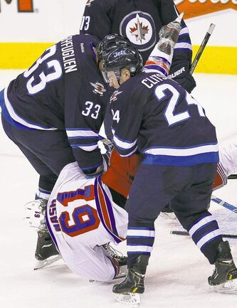 Winnipeg defencemen Dustin Byfuglien and Grant Clitsome take down New York�s Rick Nash at the MTS Centre Thursday night.