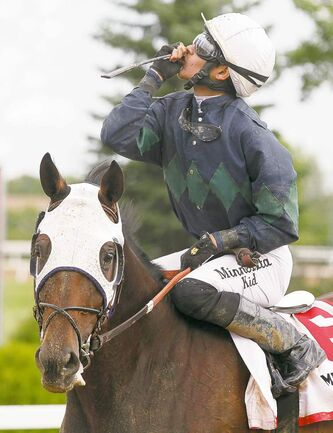 Jockey Alex Canchari and Assembly Hall win the 65th Manitoba Derby on Monday at Assiniboia Downs.