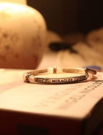 A bracelet on Griffiths' bedside table, given to her by a friend, is engraved with the word 'Miracles.'