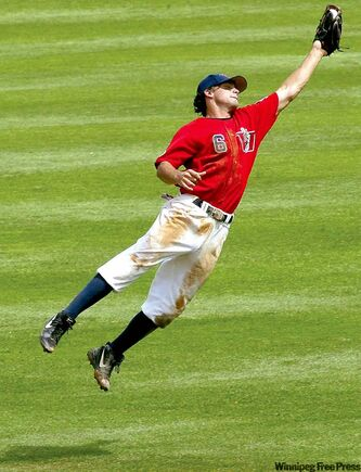 Acrobatic catches, like this one in 2003, helped make Goldeyes shortstop Max Poulin a fan-favourite at Canwest Park.
