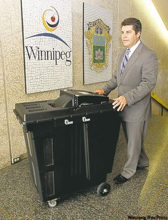 Marc Lemoine, senior election official, with new voting machine.