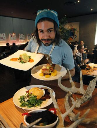 Deer + Almond owner/ chef Mandel Hitzer  with, from front: filthy dirty pie, Benny and the Jets , pork belly and steelhead trout.