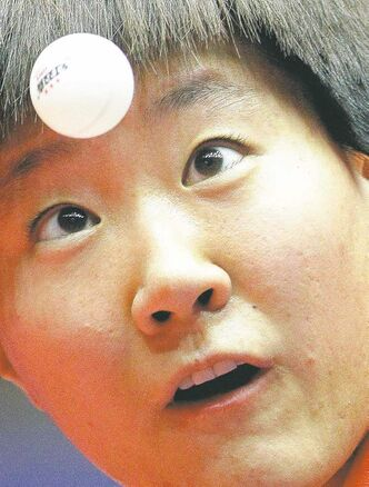 Eye on the ball. A young Chinese table tennis player focuses on the immediate obstacle to Olympic glory.