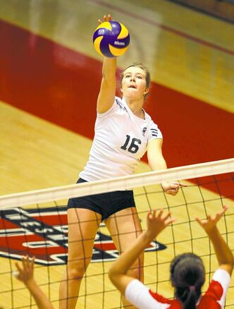 BORIS MINKEVICH / WINNIPEG FREE PRESS Neelin's Kristine Ward hammers the ball over the Glenlawn block Wednesday night.