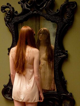 Kaylie (Karen Gillian) takes a pause for reflection in Oculus.