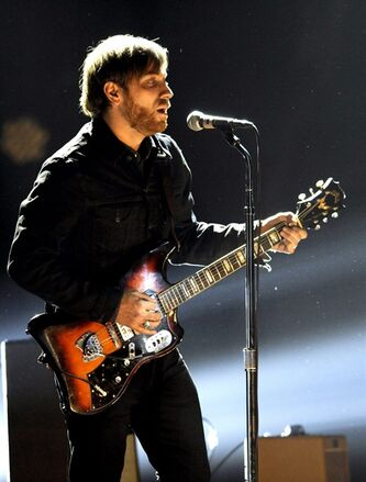 FILE - In a Saturday, Dec. 10, 2011 file photo, Dan Auerbach, lead singer of The Black Keys, performs at Spike TV's Video Game Awards, in Culver City, Calif. The eclectic mix of The Black Keys, Skrillex and Mac Miller lead nominees for the 2012 mtvU Woodie Awards. The awards show will take place March 15 in Austin, Texas, during the South By Southwest Music Festival. (AP Photo/Chris Pizzello, File)