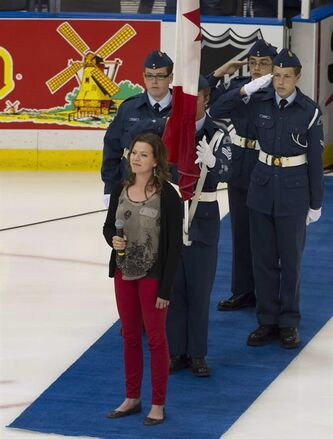 Alexis Normand smiles after successfully singing the Canadian national anthem at the Memorial Cup action in Saskatoon, Sask. on May 21, 2013. THE CANADIAN PRESS/Liam Richards