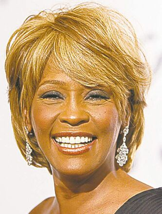 Musician Whitney Houston arrives at the 17th Carousel of Hope Ball benefiting the Barbara Davis Center for Childhood Diabetes in Beverly Hills, Calif. on Saturday, Oct. 28, 2006. (AP Photo/Matt Sayles)
