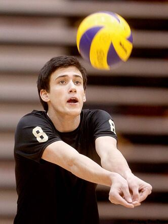Freshman setter Chris Komishon practises with his teammates Thursday as the Bisons men's volleyball team prepares to host the Alberta Golden Bears.