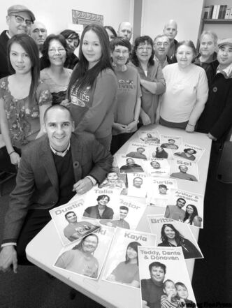 Kevin Chief (foreground) at his constituency office with volunteers and portraits of volunteers.   Saturday special story on Kevin Chief and how he engaged the community to vote, including recruiting local residents to volunteer at his office.  Dan Lett story    (WAYNE GLOWACKI/WINNIPEG FREE PRESS) Winnipeg Free Press Nov.4 2011