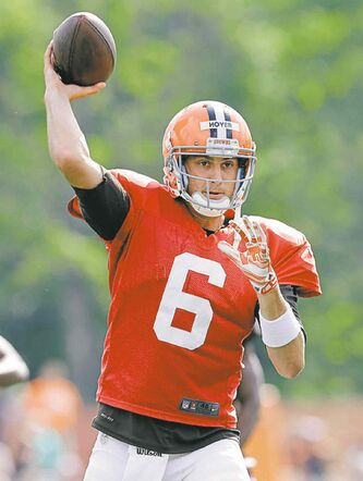 Cleveland Browns quarterback Brian Hoyer passes during practice at NFL football training camp in Berea, Ohio Wednesday, Aug. 6, 2014. Coach Mike Pettine is expected to name his starting quarterback for Saturday night's exhibition opener in Detroit. Hoyer is listed first on the team's depth chart, but rookie Johnny Manziel may be gaining on him. (AP Photo/Mark Duncan)
