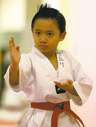 TREVOR HAGAN / WINNIPEG FREE PRESS Anthony Contreras, 6, tests for his poom, or junior black belt in taekwondo, at Choi's Taekwondo in Garden City Shopping Centre.