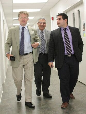 Bob Nazarian (centre), owner of the ill-fated Algo Centre Mall, leaves the inquiry into the mall's collapse with his son Levon (right) and lawyer Derek Fulton on Wednesday, July 24, 2013, in Elliot Lake, Ont. THE CANADIAN PRESS/Colin Perkel
