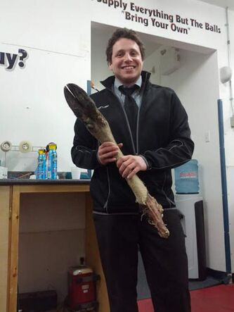 A beaming Bradley Karp, play-by-play voice of the OCN Blizzard, holds the moose leg thrown on the ice after Game 6.