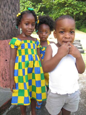 Children sport the colours of the flag in honour of SVG's Independence Day on Oct. 27