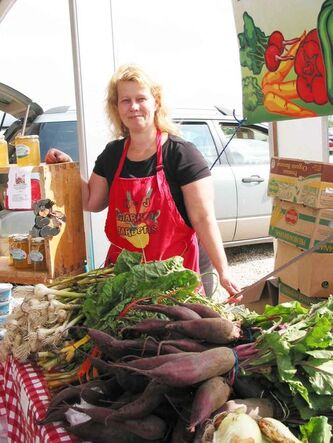 Julie Paseschnikoff sells the family's produce at the Saturday farmers market at Red River Exhibition Park. The market is open from 9 a.m. to 2 p.m.