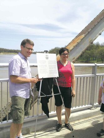 Coun. Brian Mayes (St. Vital) and Coun. Jenny Gerbasi (Fort Rouge-East Fort Garry) pictured recently with a plaque to celebrate the 100th anniversary of the Elm Park Bridge.
