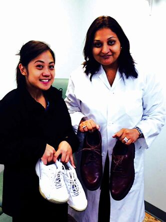 Dr. Tejel Patel (right) and her assistant, Melissa Ilagan, hope individuals will drop off pairs of gently-used shoes at Lakewood Foot Clinic, located at 96 Drake Blvd.