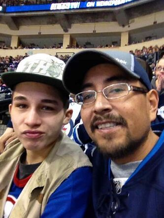 Ethan Williams with his father, Chris. Ethan, a rising junior hockey star, killed himself in late July.