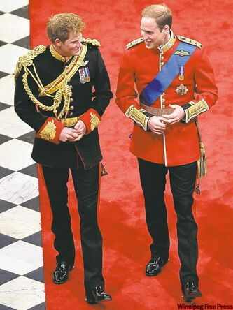 Britain's Prince Harry, left, best man to Britain's Prince William, right, arrive ahead of Prince William's marriage to Kate Middleton at Westminster Abbey.