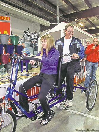 Jillian Chipilski and her dad Fern on her new Freedom Concepts bicycle.