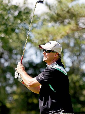Former Winnipeg Jet Dale Hawerchuk swings the sticks at Pine Ridge Golf Club on Wednesday.