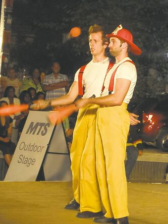 "The Circus Firemen, Angus and Matilda, say ""a city is a city."""