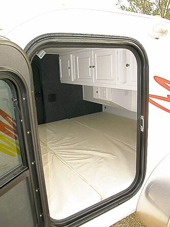 Despite its small exterior dimensions, the interior of the Little Guy trailer features a king-size mattress, roof-mounted fan, electrical outlets, lighting and several storage cupboards.