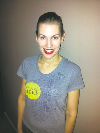 Jessica Alkans models a We Are Here T-shirt.