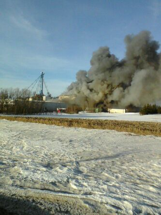 Smoke rises from the Glanbia industrial complex south of Angusville.