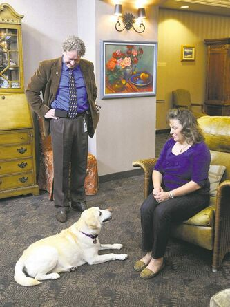 Pickell and Rosie visit with Roxanne Poole,  daughter of a patient being cared for at the hospice.