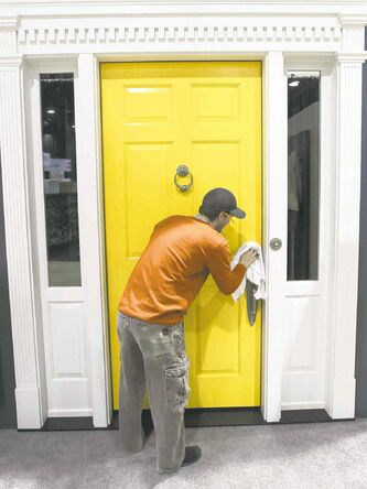 Mark Heimpel puts the finishing touches on a door from Yarrow Sash and Door.