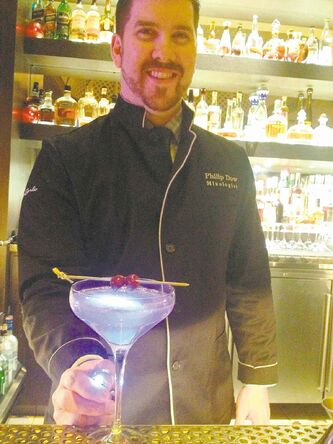 Philip Dow, assistant beverage manager at Hit Bar & Lounge at the Monte Carlo, shows newbies how to concoct a perfect cocktail.