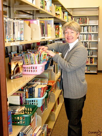 Headingley Municipal Library head librarian Joan Spice shelves books in the young adults section.