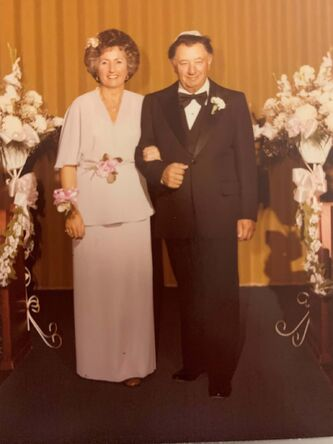 <p>Supplied</p><p>Carmela and Nathan Finkel at their daughter, Gina's, wedding in June of 1980.</p>