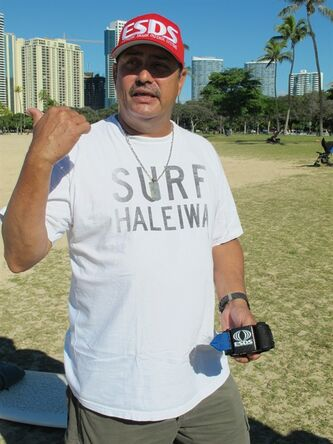 Wilson Vinano, holds a shark deterrent device he invented, the Electronic Shark Defense System, in Honolulu on Dec. 17, 2013. A surge in shark attacks on Maui hasn't stopped people from surfing and swimming in the warm ocean waters that surround this Hawaiian island. But it has spurred sales of devices that claim to keep sharks away by emitting an electric pulse. (AP Photo/Audrey McAvoy)